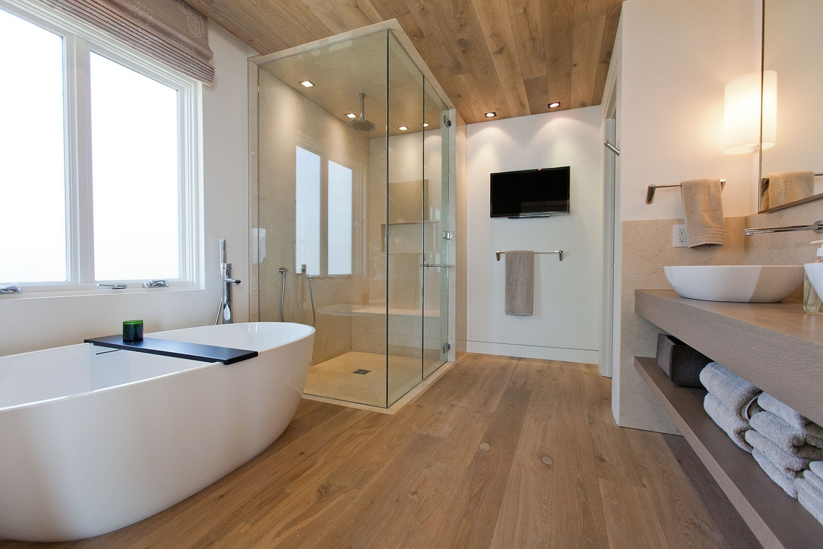 Large-bathroom-design-with-oversize-bathrub-and-long-cabinet-also-wood-floor-and-ceiling